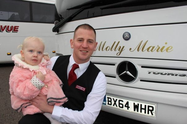 Belle Vue coaches have put names of driver's children and grandchildren on their vehicles Pictured is Driver Rob Gill with Molly Marie Gill